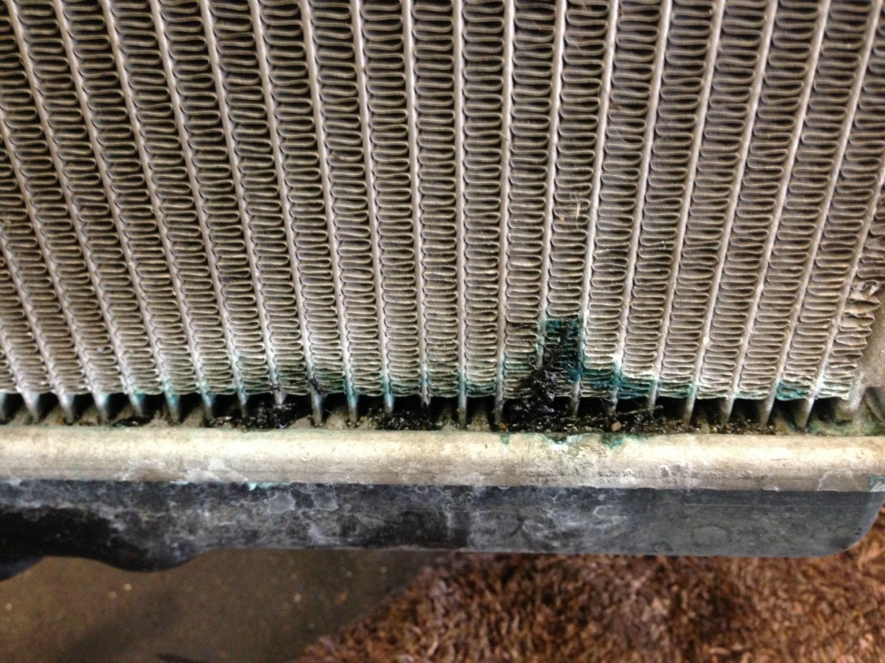 Car smells whats causing it and how to fix it this radiator is leaking at the bottom tank this is a very common coolant leak for honda ridgeline and pilot fandeluxe Image collections